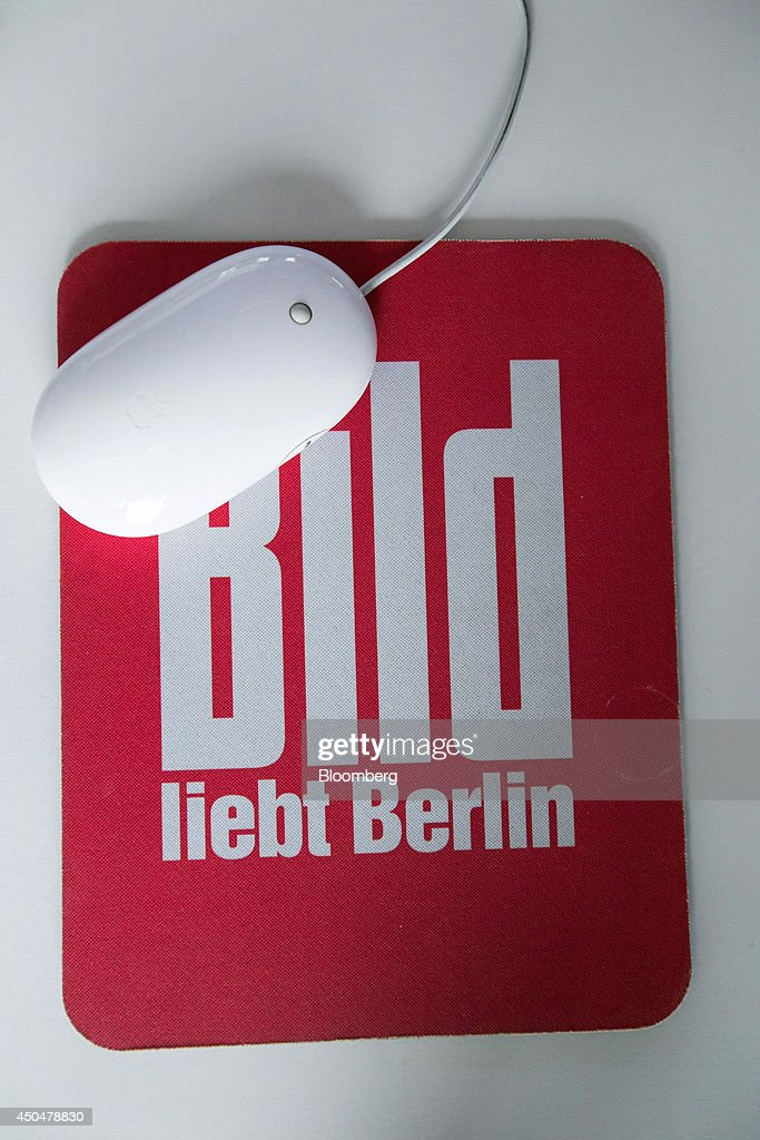 The logo of tabloid newspaper Bild, published by Axel Springer SE, sits on a computer mouse mat inside the company's offices in Berlin, Germany, on Wednesday, June 11, 2014. Axel Springer SE, Europe's biggest newspaper publisher, is working with JPMorgan Chase & Co. and Citigroup Inc. on an initial public offering of its digital-classifieds business, people familiar with the matter said. Photographer: Krisztian Bocsi/Bloomberg via Getty Images