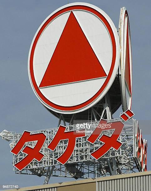 The logo of Takeda Pharmaceutical Co sits atop the company's Osaka plant in Osaka City Japan on Sunday Nov 4 2007 Takeda Pharmaceutical Co and Abbott...