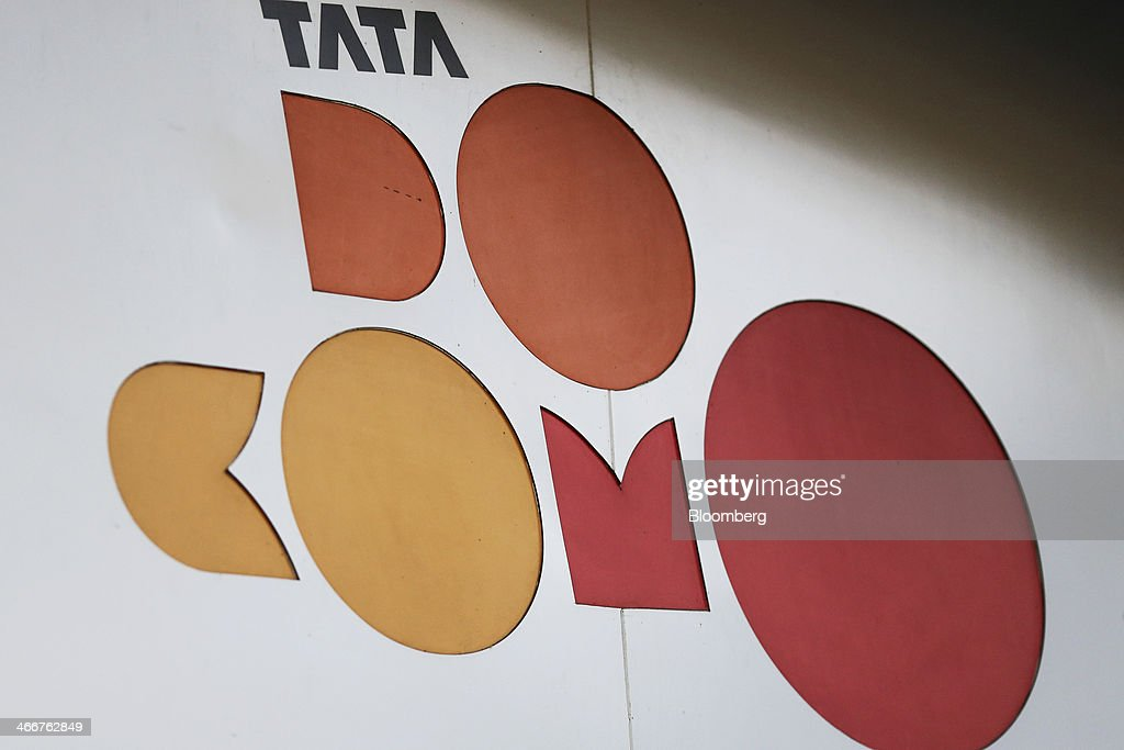 The logo of Tata DoCoMo, the joint venture between NTT DoCoMo Inc. and Tata Teleservices Ltd., is displayed at one of the company's stores in Mumbai, India, on Wednesday, Jan. 29, 2014. India got bids totaling 446.1 billion rupees ($7.12 billion) on the first day of a wireless spectrum auction on Feb. 3, the third effort by the government to raise revenue from the sale of airwaves in the last 15 months. Photographer: Dhiraj Singh/Bloomberg via Getty Images