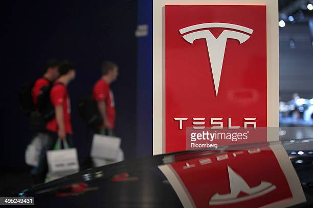 The logo of Tesla Motors Inc sits on a sign on the manufacturer's stand at the Auto Mobil International automotive trade fair at Leipziger Messe in...