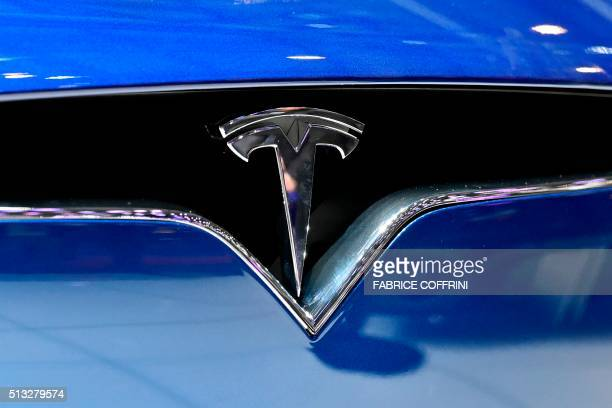 The logo of Tesla Motors is seen at the stand of US carmaker during the press day of the Geneva Motor Show on March 2 2016 in Geneva / AFP / FABRICE...
