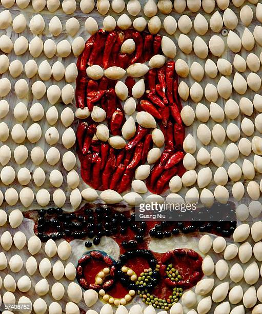 The logo of the 2008 Olympic Games is formed by vegetables and fruits at an agriculture fair on April 20 2006 in Weifang Shandong province of China...