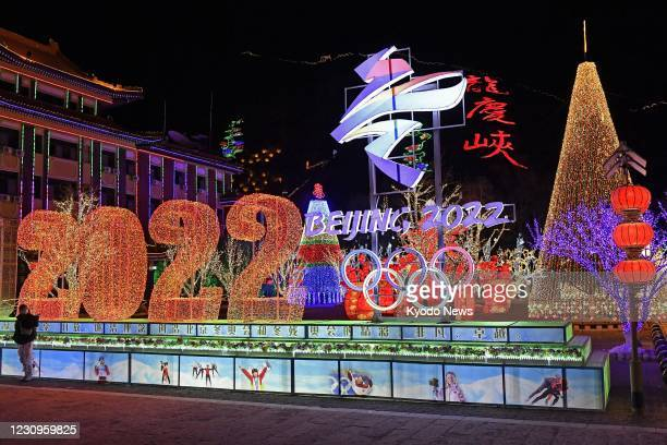 The logo of the 2022 Beijing Winter Olympics is lit up at an ice and snow festival in the Yanqing district of the Chinese capital on Feb. 3 almost a...
