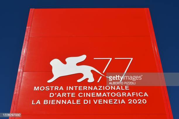 The logo of the 77th Venice Film Festival is pictured on the festival's palace on the eve of the festival's opening, on September 1, 2020 at Venice...