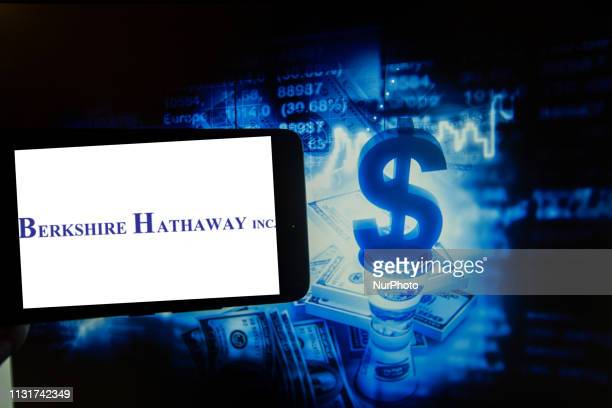 The logo of the American multinational conglomerate holding company headquartered in Omaha Nebraska United States Berkshire Hathaway is seen on a...