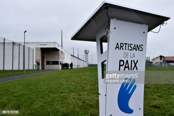 The logo of the 'Artisans de la paix' movement is pictured at the ReauSud Francilien prison on December 7 2017 in Reau prior to a march to protest...