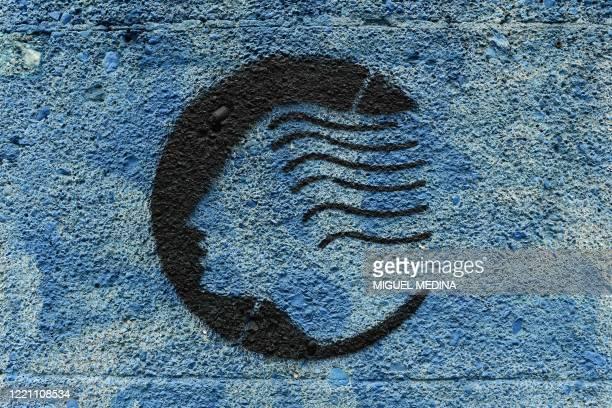 The logo of the Atalanta Bergamo football club is pictured on June 16, 2020 on a wall of the Atleti Azzurri d'Italia stadium in Bergamo. - Bergamo,...