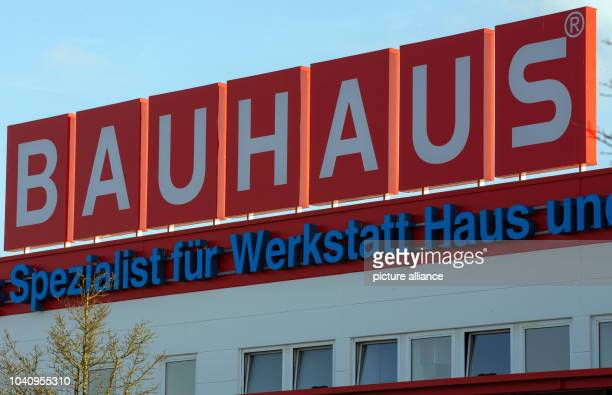 The logo of the Bauhaus hardwear store chain is seen at a Bauhaus store in Schwerin Germany 09 March 2015 The 'Handelsverband Heimwerken Bauen und...