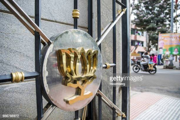 The logo of the Bharatiya Janata Party is displayed on a gate at the party's office in Bengaluru Karnataka India on Wednesday March 14 2018 Prime...