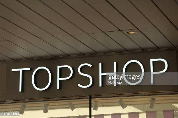 The logo of the British multinational fashion retailer of clothing shoes makeup and accessories TOPSHOP is seen in the Munich pedestrian zone