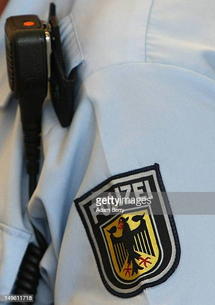 The logo of the Bunespolizei is seen on a police officer's uniform at Tegel airport on August 1 2012 in Berlin Germany The topic of today's German...