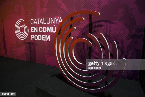 The logo of the Catalunya en ComPodem party sits on a stage at the party's headquarters in Barcelona Spain on Thursday Dec 21 2017 An election in...