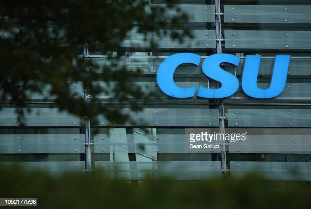The logo of the Christian Social Union hangs from party headquarters prior to a meeting of the CSU leadership at party headquarters on October 15...