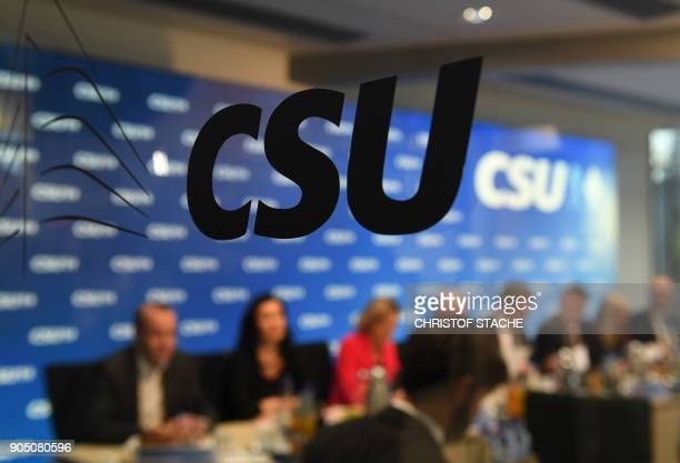 The logo of the Christian Social Union is seen on a window in front of members of the party during a board meeting on January 15 2018 at the party...