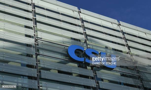The logo of the Christian Social Union is seen on the outside of the party headquarters in Munich southern Germany pictured on January 15 2018 / AFP...