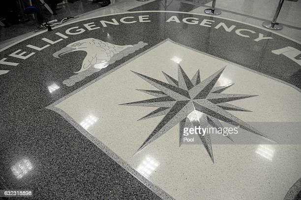 The logo of the CIA is seen during a visit ofUS President Donald Trump the CIA headquarters on January 21 2017 in Langley Virginia Trump spoke with...