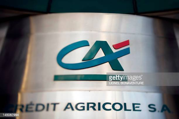 "The logo of the ""Credit Agricole"" bank sign is seen on December 14, 2011 in Paris. French banking group Credit Agricole is to cut 2,350 jobs around..."