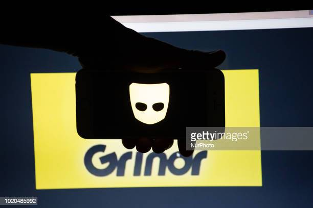 The logo of the dating app Grindr is seen on a mobile screen and a laptop screen Grindr is a dating app for gay bi pan and curious men Several...