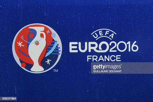 The logo of the Euro 2016 football tournament is pictured under heavy rain outside the stadium in Tours on June 10 2016 ahead of the Euro 2016...