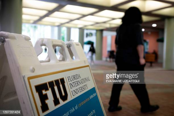 The logo of the Florida International University is seen on a sign at Florida International University in Miami, Florida, on March 11, 2020. - For...