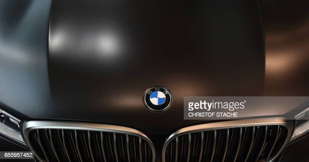 The logo of the German car maker BMW is seen on a car prior to the company's annual press conference in Munich southern Germany on March 21 2017 /...