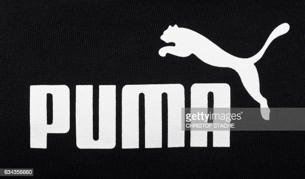 The logo of the German sportswear maker Puma is seen in a Puma store after the company's annual press conference on February 9, 2017 in...
