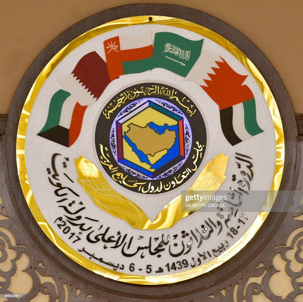 The logo of the Gulf Cooperation Council is pictured at the GCC summit in the Bayan palace in Kuwait City on December 5, 2017. The Gulf Cooperation Council, which launches its annual summit today in Kuwait amid its deepest ever internal crisis, comprises six Arab monarchies who sit on a third of the world's oil. A political and economic union, the GCC comprises Saudi Arabia, the United Arab Emirates, Kuwait, Qatar, Oman and Bahrain. Dominated by Riyadh, it is a major regional counterweight to rival Iran. CACACE
