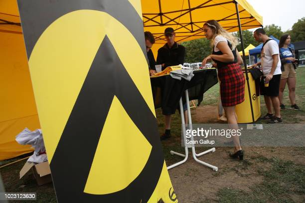 The logo of the Identitarian Movement stands at a gathering entitled Europa Nostra and hosted by the Identitarian Movement on August 25 2018 in...