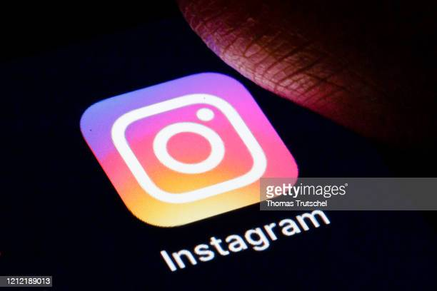 The logo of the Instagram app can be seen on the display of a smartphone on May 04, 2020 in Berlin, Germany. Instagram is an ad-supported online...