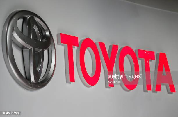 The logo of the Japanese car manufacturer Toyota is on display during the second press day of the Paris Motor Show at the Parc des Expositions at the...