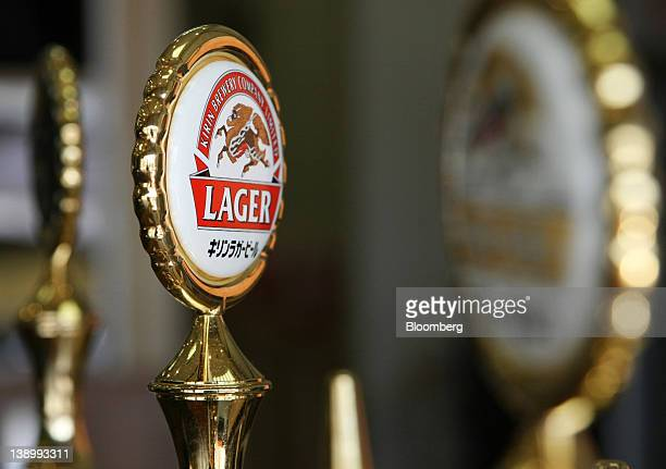 The logo of the Kirin Brewery Co Kirin Lager beer is displayed on a beer pump at the company's plant in Sendai City Miyagi Prefecture Japan on...