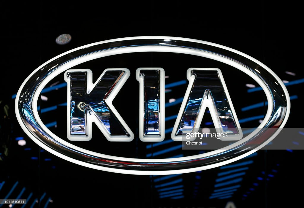 The Logo Of The Korean Car Manufacturer Kia Is On Display During The