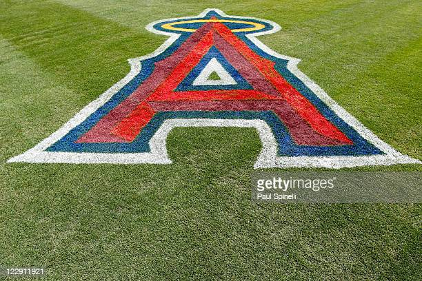The logo of the Los Angeles Angels of Anaheim is painted on the grass during the game against the Seattle Mariners on July 10 2011 at Angel Stadium...