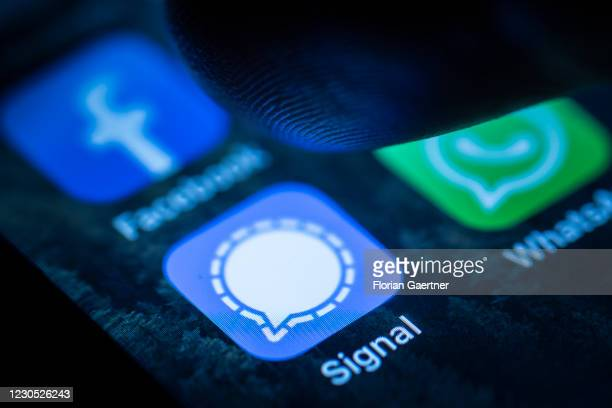 The logo of the messenger app Signal is pictured on the display of an iphone on January 10, 2021 in Berlin, Germany.