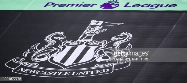The logo of the Newcastle team is displayed on the empty rows of seats at the stadium prior to the English Premier League football match between...