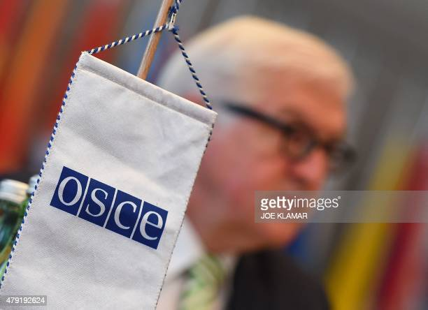 The logo of the Organization for Security and Cooperation in Europe OSCE is seen as the German Foreign Minister FrankWalter Steinmeier delivers a...