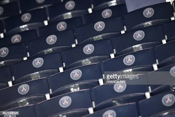 The logo of the Paris SaintGermain football club is seen on seats at the Parc des Princes stadium in Paris on October 27 prior to the French L1...
