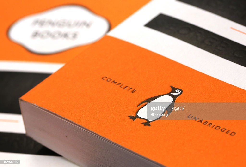 The logo of the Penguin publishing house, part of Pearson Plc, is seen on paperback books at a bookstore in London, U.K., on Friday, April 5, 2013. Bertelsmann SE's Random House won European Union approval to buy Pearson Plc's Penguin unit to create the largest book publisher in the U.K. and the U.S. Photographer: Chris Ratcliffe/Bloomberg via Getty Images