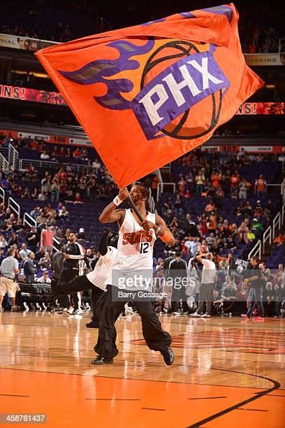 The logo of the Phoenix Suns is waved to get the crowd pumped up against the Brooklyn Nets on November 15 2013 at US Airways Center in Phoenix...