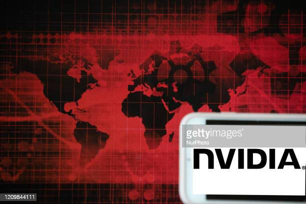The logo of the semiconductor manufacturer NVIDIA is seen on a screen of a phone next to a red illustration of world and financial markets in...