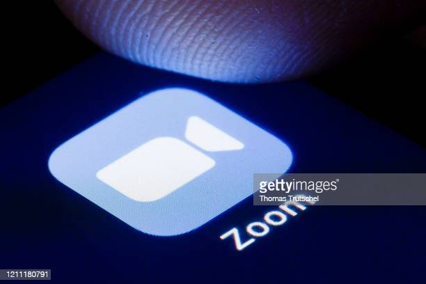 The logo of the software for video conferences Zoom is shown on the display of a smartphone on April 22, 2020 in Berlin, Germany.