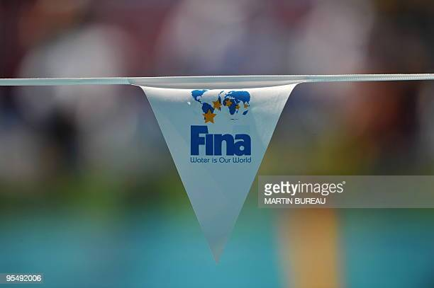The logo of the Swimming governing body FINA is displayed on a flag at the main swimming pool on July 26, 2009 at the 13th FINA World Swimming...