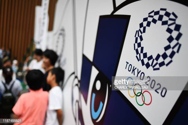The logo of the Tokyo 2020 Olympic Games is seen during the let's 55 event marking one year before the start of the games in Tokyo on July 24 2019...