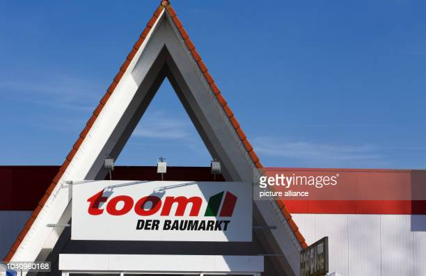 The logo of the toom hardwear store chain is seen above the entrance of a toom store in Schwerin Germany 09 March 2015 The 'Handelsverband Heimwerken...