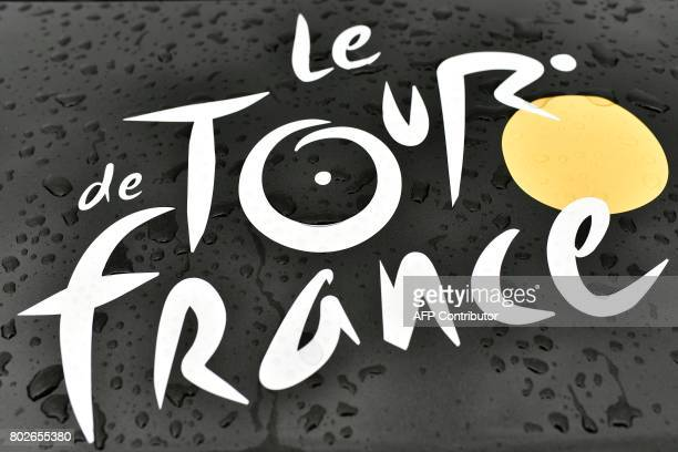 The logo of the Tour de France cycling race is seen on the hood of a car covered by drops of water in Dusseldorf Germany on June 28 three days before...