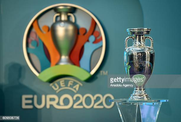 The logo of the UEFA European Championship football competition is displayed next to the Euro trophy during a launch event in London United Kingdom...