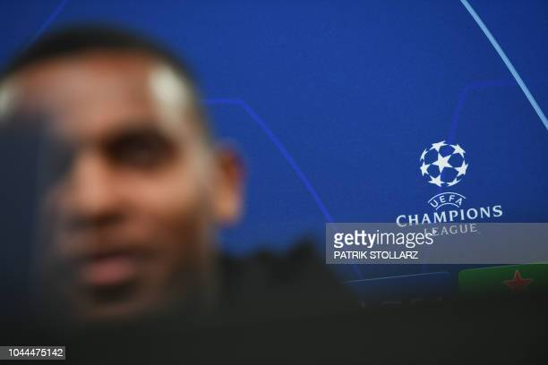 The logo of the UEFA is pictured as Dortmund's Swiss defender Manuel Akanji attends a press conference on the eve of the UEFA Champions League group...