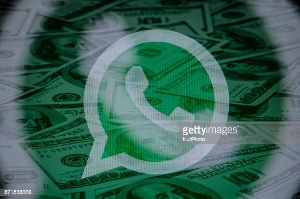 The logo of the Whatsapp messaging application is seen in this photo illustration on November 8 2017 Over 1 million users have downloaded a fake...