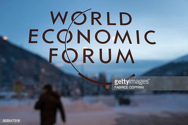 The logo of the World Economic Forum is seen on window pane at the Congress Center prior to the forum's annual meeting in Davos on January 18 2016...