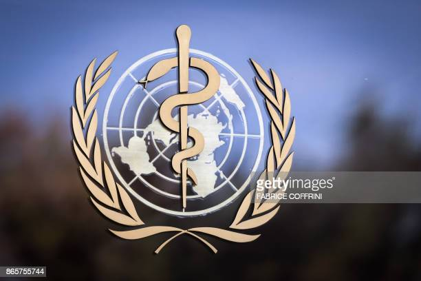 The logo of the World Health Organization is pictured on the facade of the WHO headquarters on October 24 2017 in Geneva The head of the World Health...